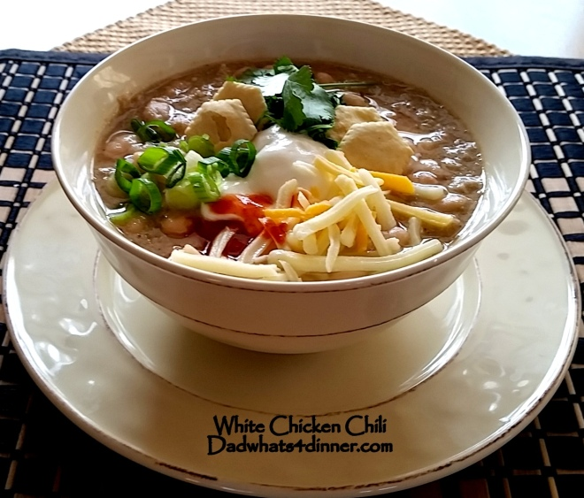 There is nothing better on a cold day than a nice warm bowl of White Chicken Chili made with chicken, white beans, cumin, mild chilies and other spices.