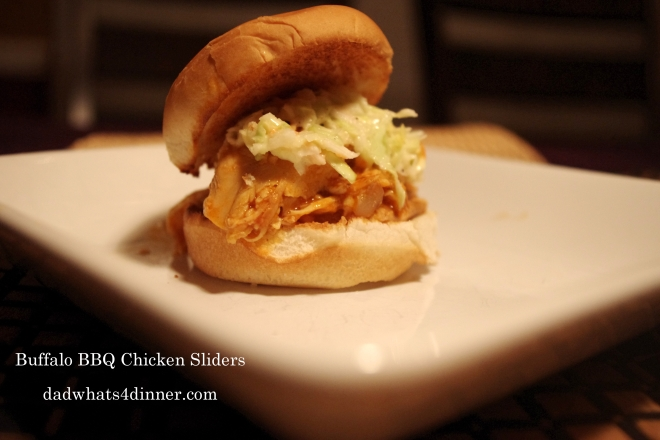 Crock Pot Buffalo BBQ Chicken Sliders with Ranch Slaw is a sweet and spicy sandwich your family will love. Great for parties or an easy dinner.